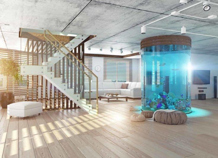 El interior moderno tipo loft con acuario.  Concepto 3d
